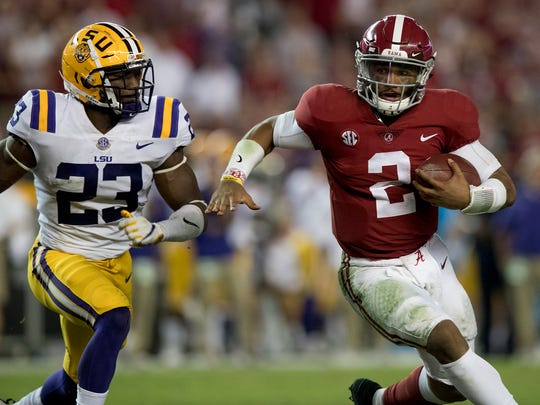 Alabama quarterback Jalen Hurts (2) is pursued by LSU