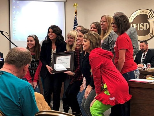 Staff members from Ben Milam Elementary pose for a