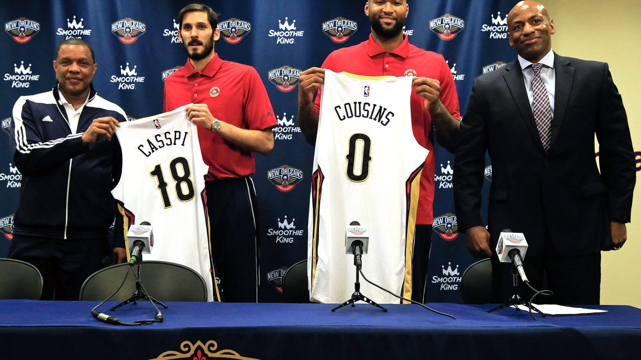 Omri Casspi (18) and DeMarcus Cousins (0) were introduced