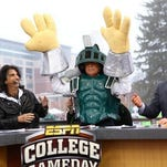 "Lee Corso picks Michigan State on ESPN's ""College GameDay"" set in East Lansing."