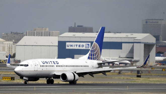 A United Airlines passenger plane lands at Newark Liberty International Airport in Newark, N.J. United is back at the Elmira Corning Regional Airport.