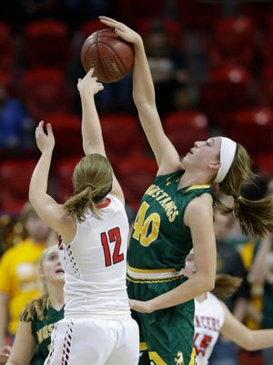 Manitowoc Lutheran High School's Grace Melso (12) gets her shot blocked by Melrose-Mindoro High School's Calette Lockington (10) during their Division 4 semifinal game at the WIAA state girls basketball tournament Thursday, March 8, 2018, at the Resch Center in Ashwaubenon, Wis. 