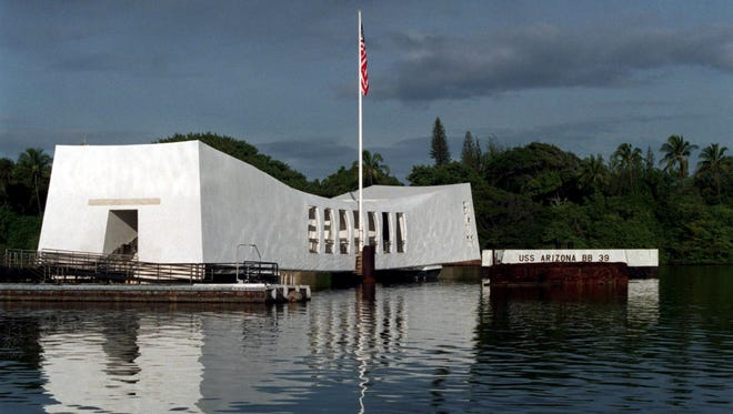 The memorial to the USS Arizona floats over the submerged battleship in Pearl Harbor, Hawaii.