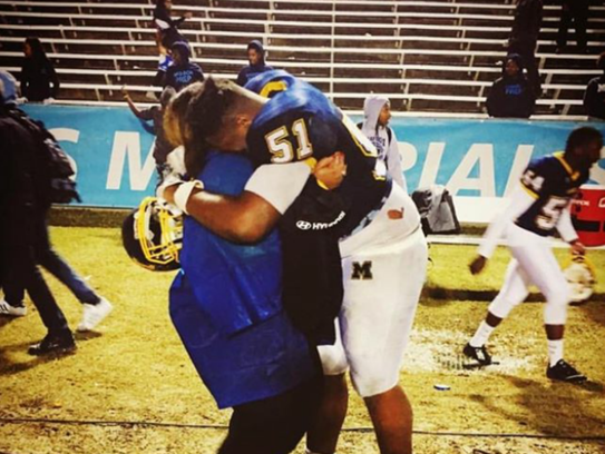 GSU recruit Edgard Franklin hugs his sister, Florida