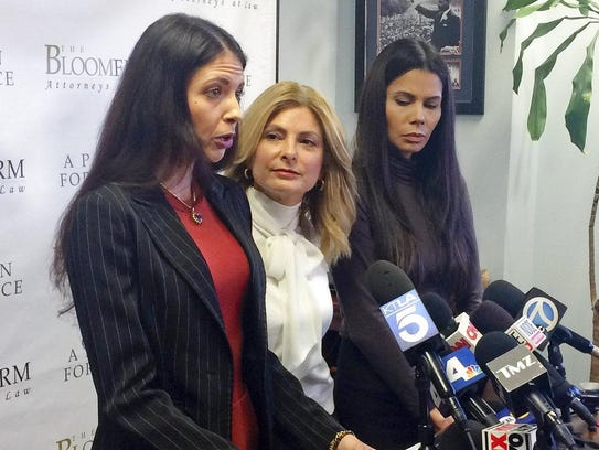 Former model Faviola Dadis, left, reads from a statement
