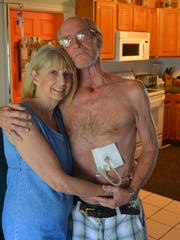 Nonsmoker Jay Post, pictured with his wife, Maggie, is a retired Brevard firefighter who underwent a total laryngectomy after being diagnosed with throat cancer. Nine months after his diagnosis and several surgeries, he is still on a feeding tube but has been cleared to eat pureed foods.