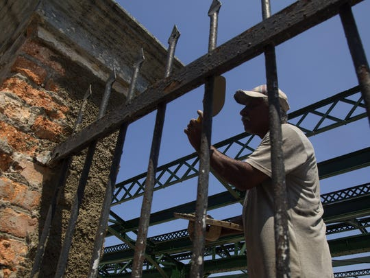 Railroad worker Norberto Rosales repairs a gate at the central train station in Havana, Cuba, Wednesday, May 22, 2019.