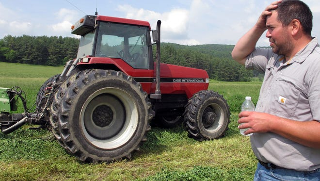 Dairy farmer Ransom Conant discusses the challenges of a wet spring as he prepares to cut an alfalfa and grass crop, in Richmond, Vt., on Tuesday, June 13, 2017, which is late for the season. Following dry and drought conditions last summer, Northeast farmers are facing the opposite challenge this growing season: a rainy, cool spring that has delayed the planting of corn and other crops and the first cutting of hay for livestock feed.