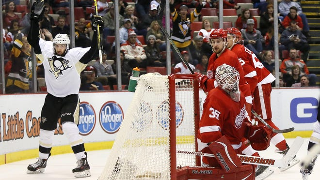 Nick Bonino completes the rout by scoring the Penguins' seventh goal. After Petr Mrazek allowed four goals, Jimmy Howard allowed three.