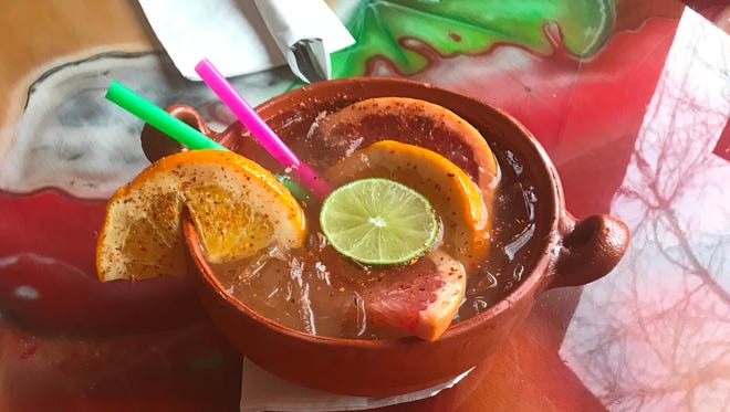 The cazuela is a tequila-lime drink with grapefruit, orange and lime slices, served in a cazuela, or small clay casserole dish at El Patron, 2423 S. 6th St.