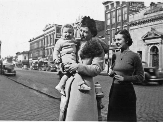 Betty Houck holding Phillip Luce with Jane Misamore on Main Street in Lancaster, 1938.