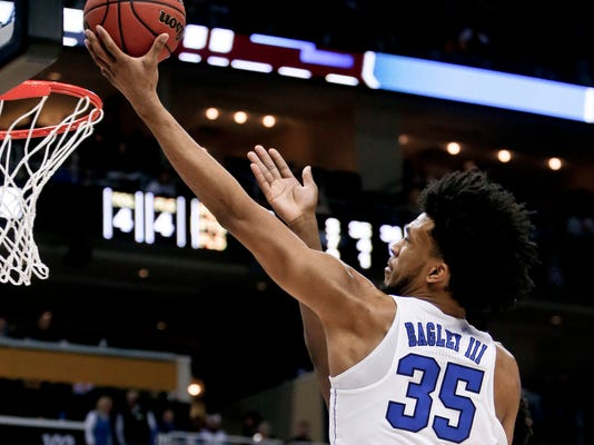 FILE - In this Saturday, March 17, 2018, file photo, Duke's Marvin Bagley III (35) shoots against Rhode Island during the first half of a second-round game in the NCAA men's college basketball tournament in Pittsburgh. Duke takes on Syracuse in a regional semifinal on Friday. (AP Photo/Keith Srakocic, File)