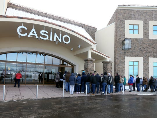 People wait outside del Lago Casino for its grand opening