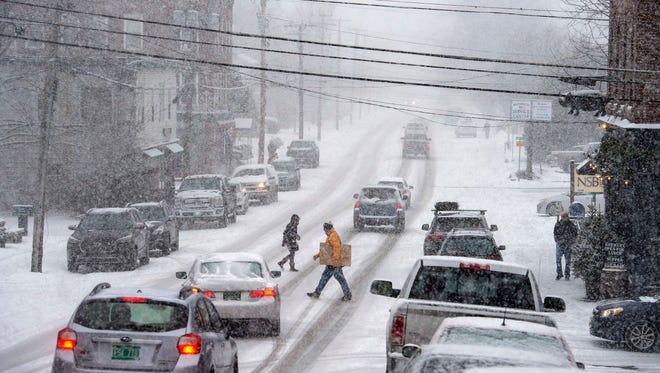 Snow falls on Main Street in Waterbury on Thursday, December 29, 2016.
