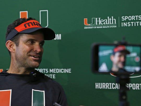 University of Miami NCAA college football head coach Manny Diaz talks to the media after practice in Coral Gables, Fla., Wednesday, Aug. 21, 2019.  (David Santiago/Miami Herald via AP)