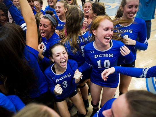 The Barron Collier volleyball team celebrates on Tuesday,