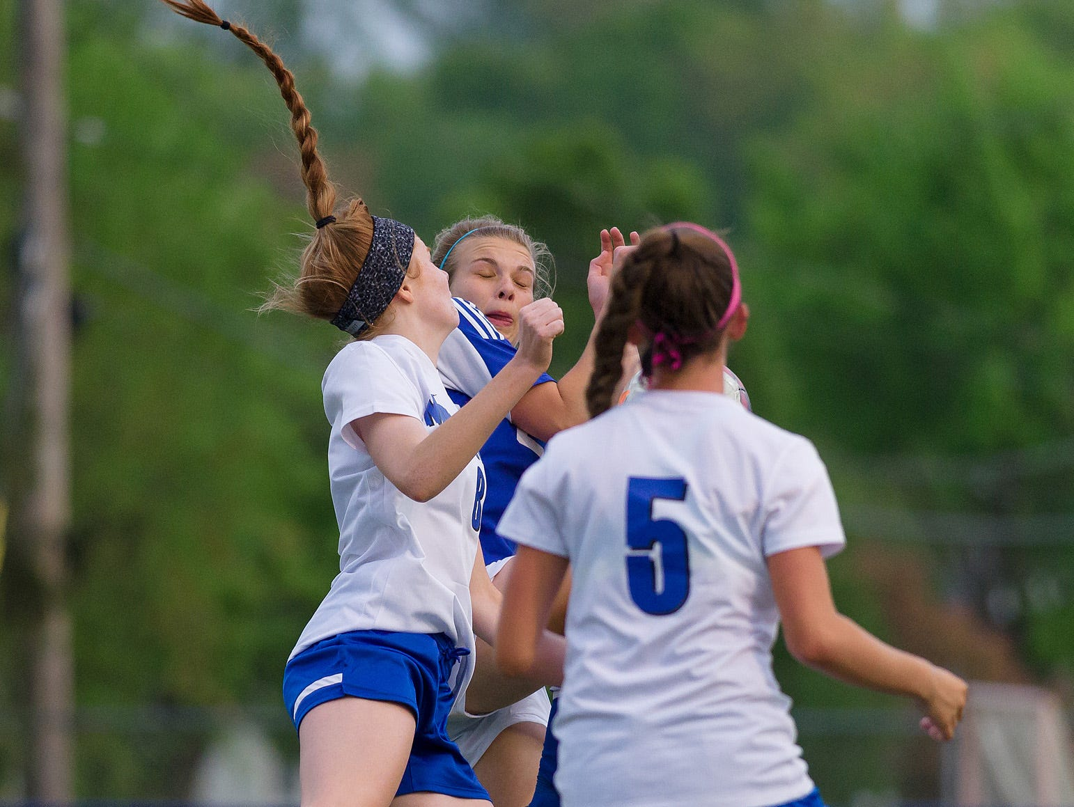 Leigh Willis (8) of Middletown and Leah Frerichs (22) of Charter collide in the air in Charter at Middletown girls soccer game on Wednesday.