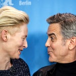 Actors Tilda Winton, left, and George Clooney attend a photo call for the movie ·Hail Caesar!  at the 2016 Berlinale Film Festival in Berlin, Germany, Thursday, Feb. 11, 2016. (Michael Kappeler/dpa via AP)