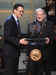 Acting Librarian of Congress David Mao presents Willie