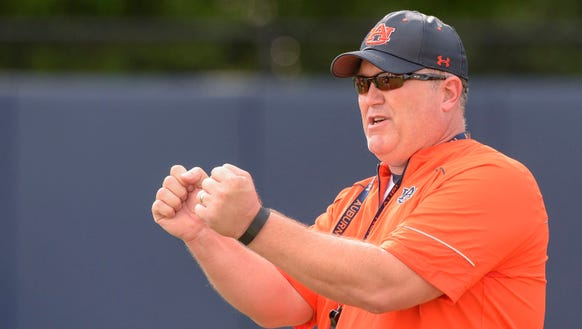 Auburn offensive line coach Herb Hand has finished