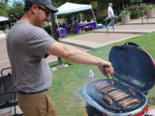 Dean Rothschadl has his brats browning before Wildcat