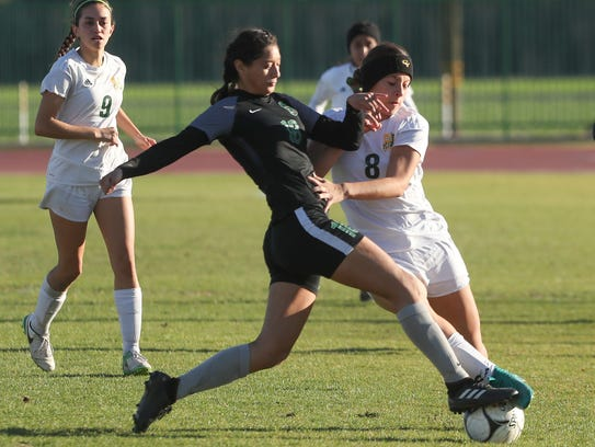 Miranda Torres of Coachella Valley fights for a loose