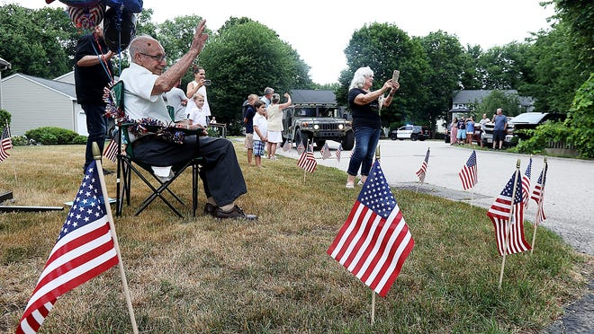 """Pellegrino """"Pelly"""" Tulimieri waves to cars as they pass by his house to wish him happy birthday when he turned 100 years old on Saturday, June 27, 2020. The World War 2 veteran served in the US army and fought in the European theater which included France, German, Austria, and Hungary."""