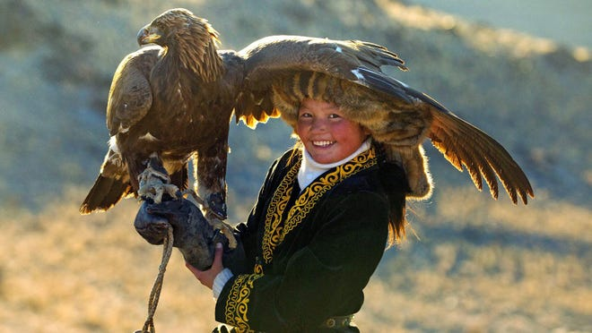 """""""The Eagle Huntress"""" documentary focuses on a bright, determined young girl, Aisholpan who practices her craft."""