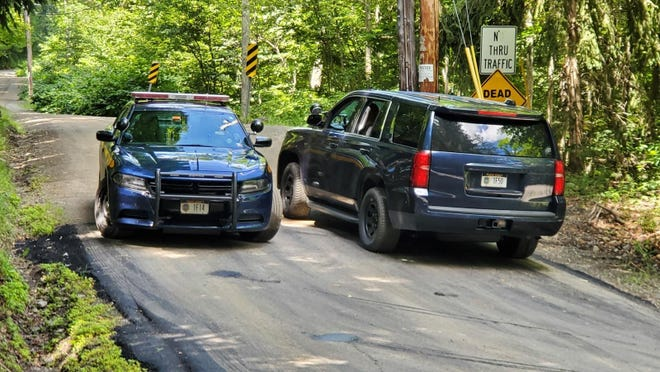 New York State Police block off a road near the scene where the body of Roy Den Hollander was found on Monday, July 20, 2020 near Livingston Manor, N.Y.