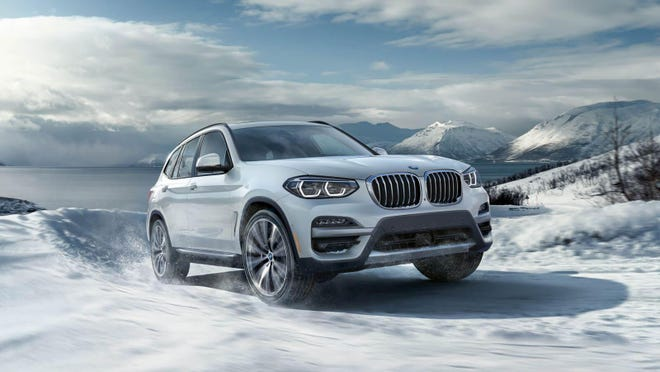 The 2020 BMW X3 xDrive30e is a compact crossover sport utility vehicle from Germany's Bavarian Motor Works, manufactured in a U.S. plant in Spartanburg, South Carolina.