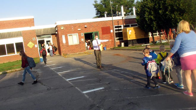 Hamilton Central School director of Instructional Technology Chris Rogers, center, directs students to their proper doors Sept. 10 on the first day of school. There might have been some rerouting and social distancing going on that was a little out of step with their last opening day, but HCS students, staff and administration all stepped up to make Sept. 10 an exciting day to finally get back to school.