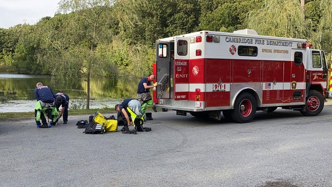 Dive team suiting up to search for missing boater on Longfellow Pond in Wellesley, Sept. 7, 2020.  [WCVB Photo/Shaun Chaiyabhat)