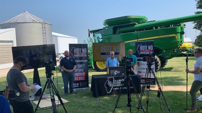 Illinois Farm Bureau President Richard Guebert Jr. prepares for a news conference Tuesday at a farm in Auburn as his organization and three others held concurrent events in opposition to the graduated income tax amendment on the Nov. 3 ballot.