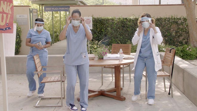 """Writers on ABC's """"black-ish"""" integrated scenes that addressed the pandemic."""