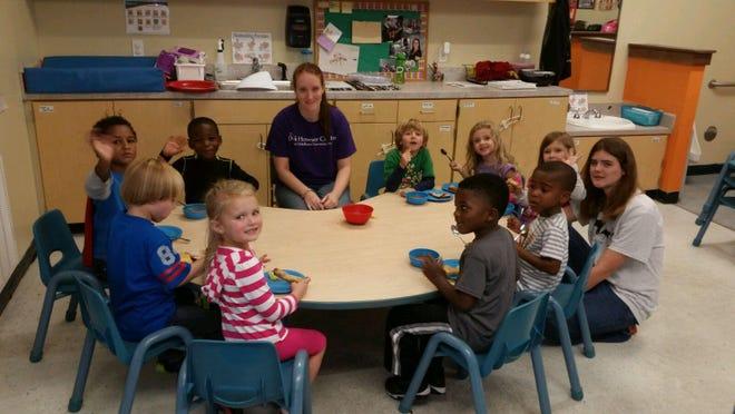 Mentees had fun volunteering at the Dick Howser Preschool.