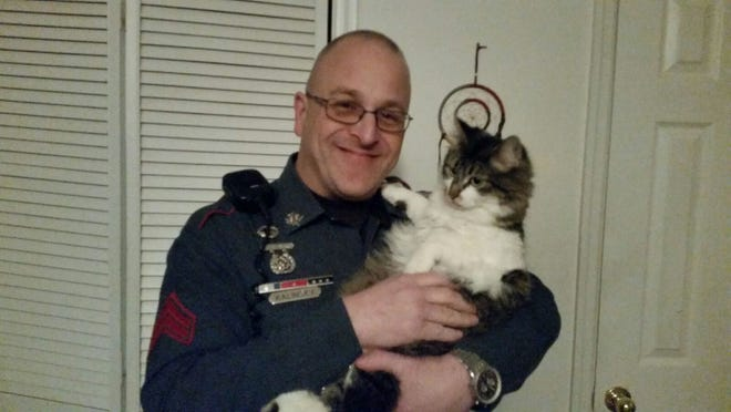 The cat belongs to Cpl. Michael Kalinsky, who thought it would be a great way to garner attention to the Facebook page.