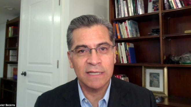 In a photo from streaming video, California Attorney General Xavier Becerra joins in an announcement of cease-and-desist orders being issued to the Republican Party for placing unofficial ballot collection boxes in several counties, during a virtual news conference from Sacramento, Calif., Monday, Oct. 12, 2020.