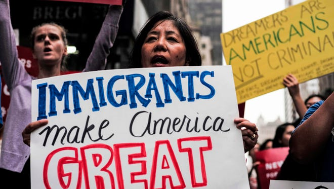 This file photo taken on Oct. 5, 2017 shows protesters during a demonstration against President Trump during a rally in support of the Deferred Action for Childhood Arrivals (DACA), near the Trump Tower in New York.