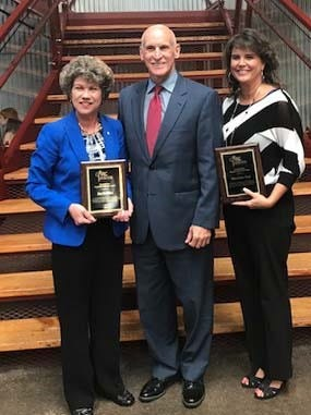 Sumner County Mayor Anthony Holt, GNRC vice president, presented the Maynard Pate Regional Leadership Award to Clarksville Mayor Kim McMillan (left) and Smyrna Mayor Mary Esther Reed on Tuesday at GNRC's 50th Annual Awards Luncheon in Franklin.
