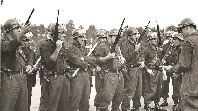 New Brunswick police prepare for the second evening of protests in July 1967.
