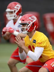 Kansas City Chiefs quarterback Alex Smith (11) participates