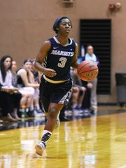 Marietta College's Amisha Herd brings the ball down the court against Muskingum University in this file photo. Herd, a junior, is a graduate of West Muskingum High School.