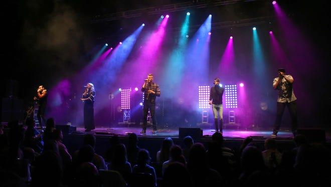 Scott Hoying, Mitch Grassi, Kirstin Maldonado, Avi Kaplan and Kevin Olusola with Pentatonix performs during the Star 94 Jingle Jam 2015 at the Fox Theatre on Monday, Dec. 14, 2015, in Atlanta.