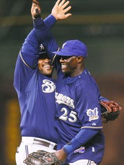 Milwaukee Brewers outfielder Mike Cameron (right) celebrates