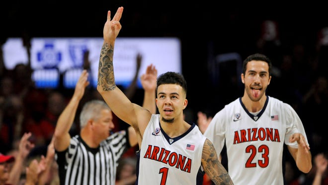 Mar 5, 2016: Wildcats guard Gabe York (1) and forward Mark Tollefsen (23) celebrate after scoring against the Stanford Cardinal during the first half at McKale Center.