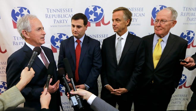 Sen. Bob Corker, R-Tenn., left, speaks before the Tennessee Republican Party's 2016 Statesmen's Dinner on May 13 in Nashville. With Corker are, from left, state Republican party Chairman Ryan Haynes, Tennessee Gov. Bill Haslam, and Sen. Lamar Alexander, R-Tenn.
