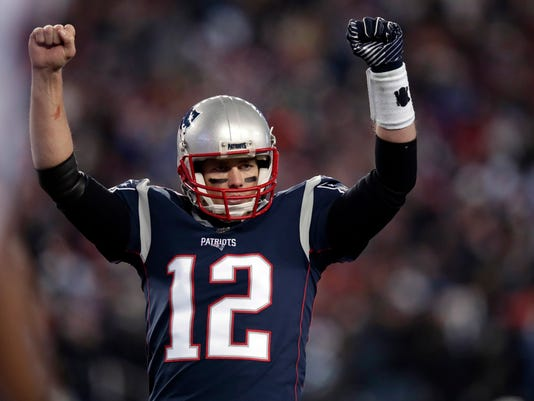 New England Patriots quarterback Tom Brady celebrates a touchdown by James White during the first half of an NFL divisional playoff football game against the Tennessee Titans, Saturday, Jan. 13, 2018, in Foxborough, Mass. (AP Photo/Charles Krupa)