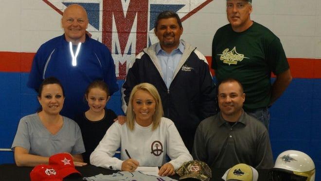 McDowell softball coach Bill Taylor (back row, far left) recently resigned.