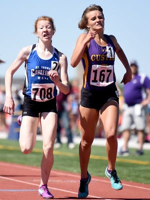 Custer's Tori Glazier (right) and St. Thomas More's Haleigh Timmer cross the finish line in the 800-meter run during the Class A South Dakota High School State Track meet on Friday in Tea.