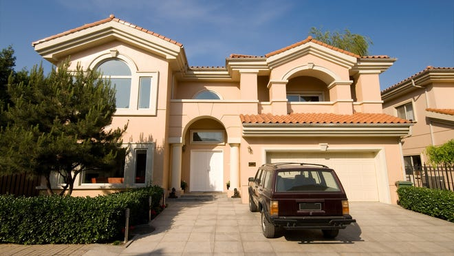 A big house and a new car are two of the biggest obstacles to saving enough for retirment.